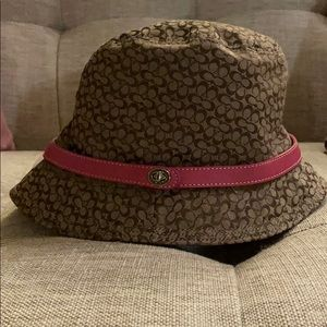 Coach Bucket hat with pink leather band and locket